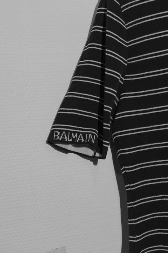 "Balmain Brand new tee with short sleeves, back neck zip closure and woven patterns in a black & grey striped colorway from Balmain Paris, size is marked as ""40"" Size US XXS / EU 40 - 2"