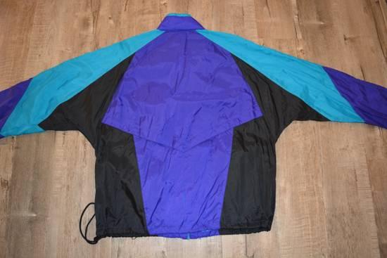 e945a945341e ... Nike Vintage Nike Aqua Charlotte Hornets Windbreaker Jacket Size US L   EU  52-54 ...