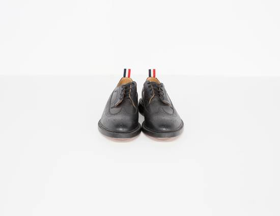 Thom Browne Classic longwing brogue in black pebble grain leather. Size US 13 / EU 46 - 1