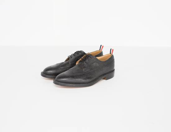 Thom Browne Classic longwing brogue in black pebble grain leather. Size US 13 / EU 46